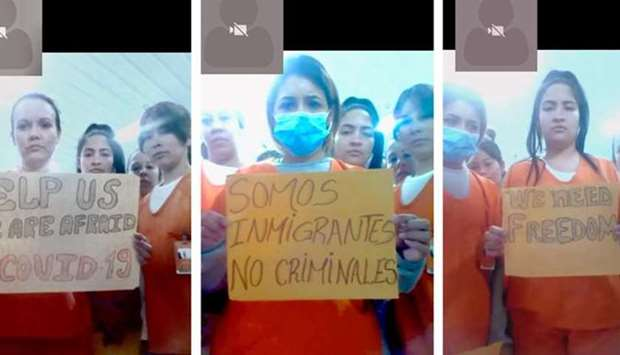 Migrants detained in an ICE detention facility in Basile, rural Louisiana, US, display signs related