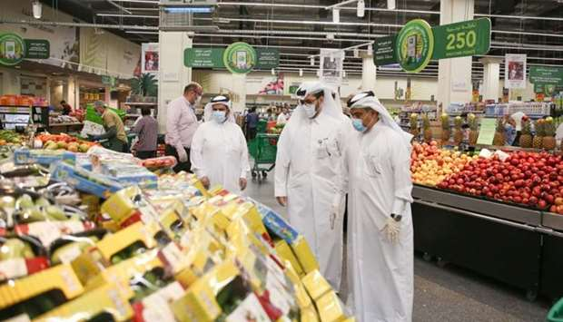 The minister inspects the goods on display at a store