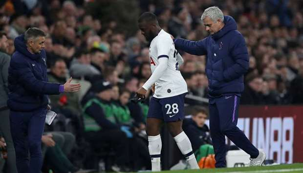 In this February 5, 2020, picture, Tottenham Hotspur manager Jose Mourinho (right) substitutes Tangu
