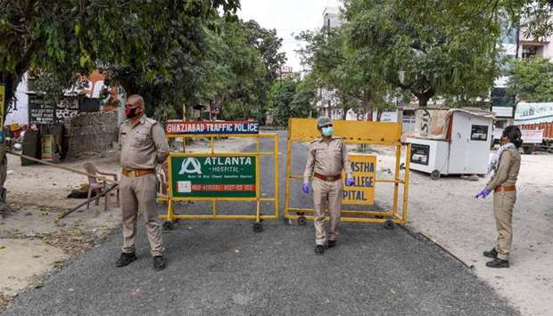 Police persoonel stand guard at the sealed entry-exit of sector-2B of Vasundhara following Uttar Pra