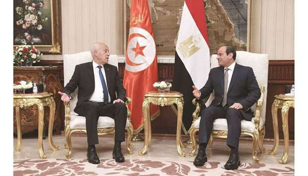 A handout picture provided by the Tunisian Presidency Facebook page yesterday shows Tunisian Preside