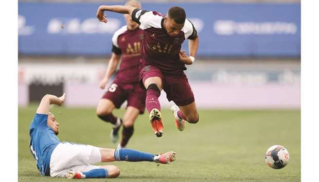 Paris St Germain's Kylian Mbappe (right) in action with Strasbourg's Frederic Guilbert during the Li