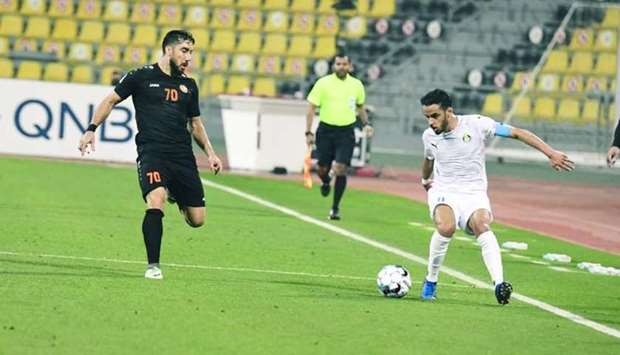 Al Gharafa's Othman al-Yahri (right) and Umm Salal's Ismail Mahmoud Mardanli in action during the QN