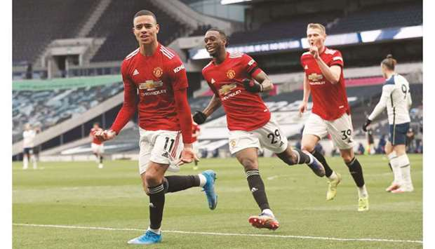 Manchester United's Mason Greenwood celebrates scoring their third goal with Aaron Wan-Bissaka and S