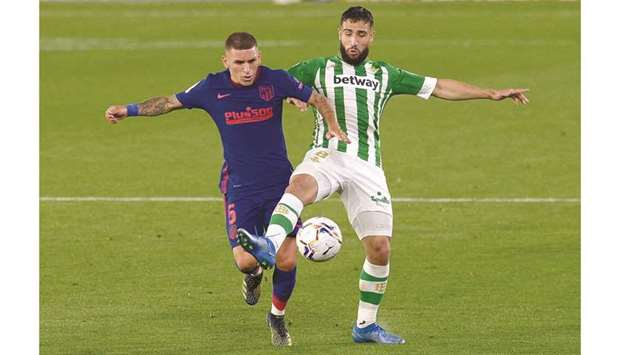 Real Betis' Nabil Fekir (right) vies for the ball with Atletico Madrid's Lucas Torreira during the L