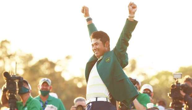 Hideki Matsuyama of Japan celebrates during the Green Jacket ceremony after winning the Masters at A