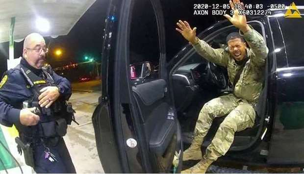 US Army 2nd Lt. Caron Nazario exits his vehicle after being pepper-sprayed by a police officer in Wi