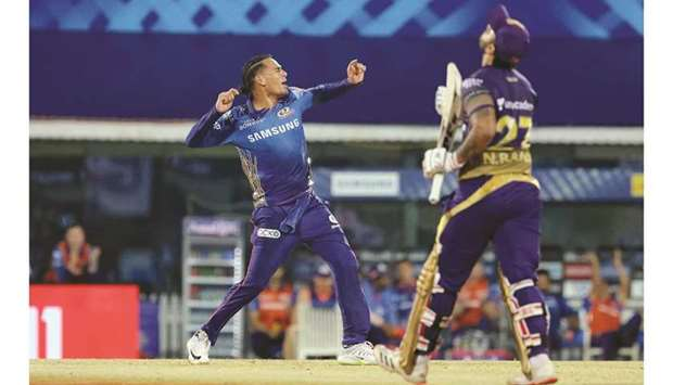 Rahul Chahar of Mumbai Indians celebrates the wicket of Nitish Rana (right) of Kolkata Knight Riders
