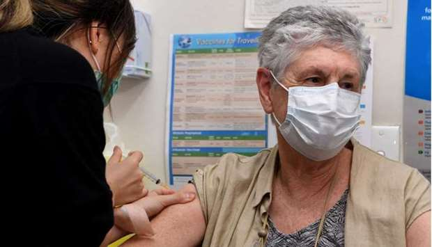 Anne Hyslop (R) receives an AstraZeneca vaccine from practice nurse Youri Park (L) in Melbourne on A