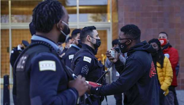 Chicago activist Ja'Mal Green (R) shouts outside the Chicago Police headquarters during a rally in C