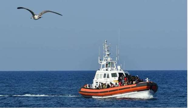 An Italian Guardia Costiera (Coast Guard) boat with migrants from Tunisia and Libya arrives in the p