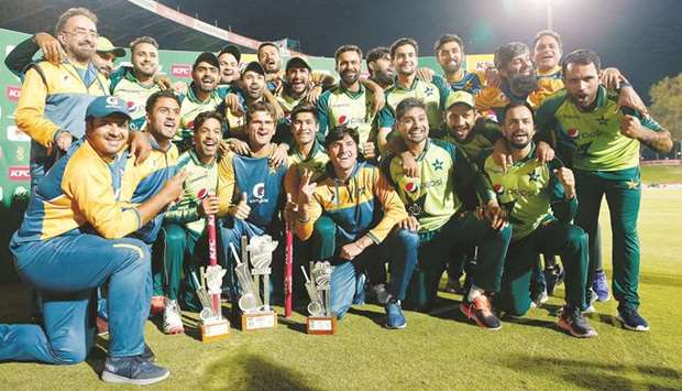 Pakistan players and support staff celebrate after the T20 series win over South Africa at SuperSpor