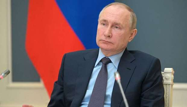 Russian President Vladimir Putin attends a session of the board of trustees of the Russian Geographi