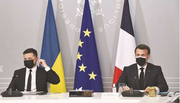 French President Emmanuel Macron and Ukrainian President Volodymyr Zelenskiy hold a news conference