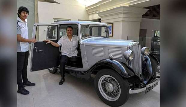 Galle Face Hotel chairman Sanjeev Gardiner (right) and his son Seshaan pose with the 1935 Standard N