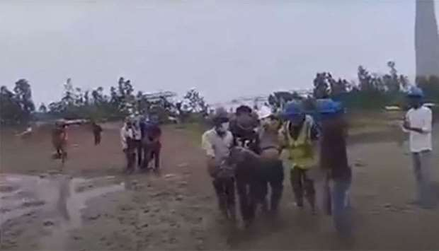An image grab taken from a video posted by Daily Star's on its website that shows the workers injure
