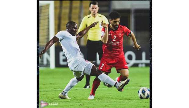 Al Rayyan's Franck Kom (left) vies for the ball with Persepolis' Omid Alishah during the group stage