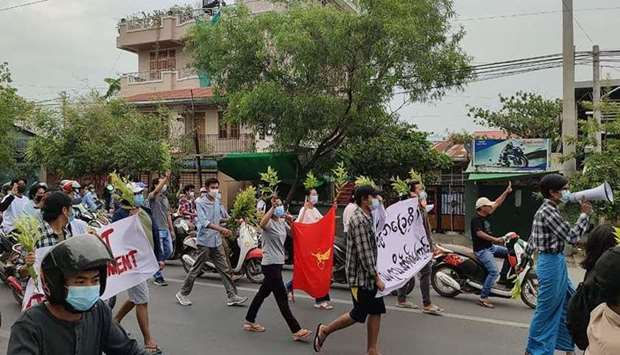 Protesters marching during a demonstration against the military coup in Mandalay.