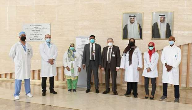WWRC's Acting Chief Executive Officer and Medical Director, Dr. Hilal Al Rifai poses in a group phot