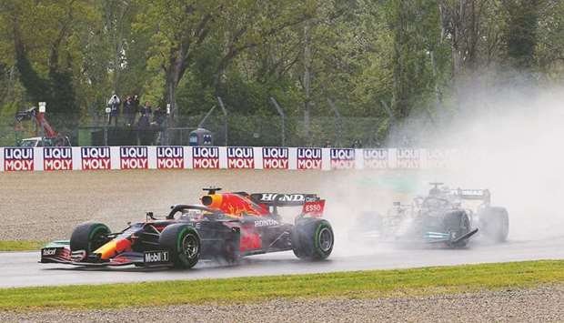 Red Bull's Max Verstappen and Mercedes' Lewis Hamilton in action during the race yesterday.