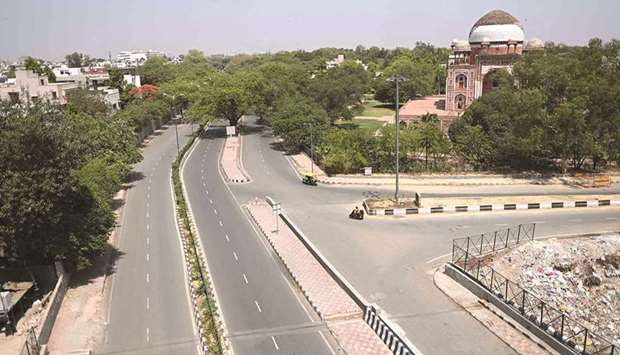 Roads lie deserted during a lockdown imposed by the government amidst rising Covid-19 cases in New D