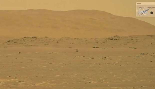 NASA's Mars helicopter Ingenuity makes its first flight on the planet in this still image taken from