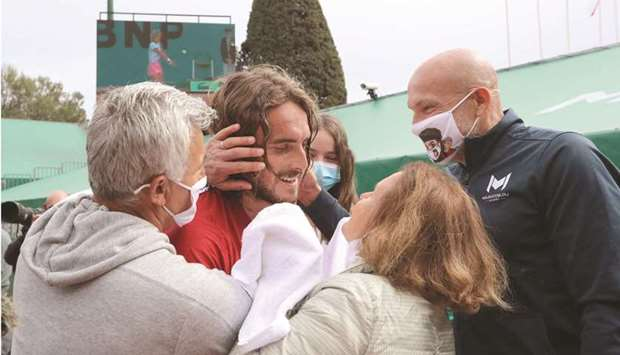 Greece's Stefanos Tsitsipas (centre) celebrates with his parents and family members after winning th