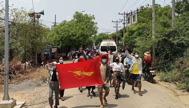 Student protesters marching during a demonstration against the military coup in Mandalay.