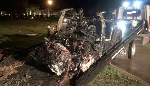 The remains of a Tesla vehicle are seen after it crashed in The Woodlands