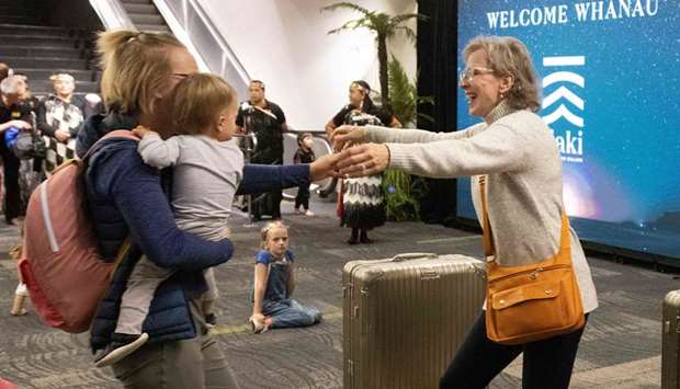 Families are reunited as travellers arrive on the first flight from Sydney, in Wellington  as Austra