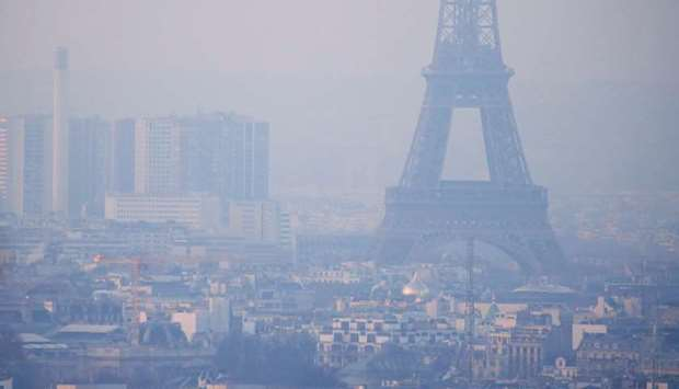 (file photo) The Eiffel Tower is surrounded by a small-particle haze which hangs above the skyline i