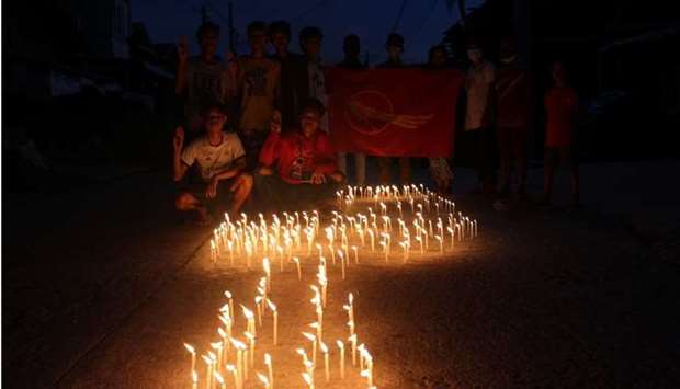 People attend sit-in protest and prayer ceremony for those who have died during protests against Mya