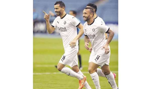 Al Sadd players Boulem Khoukhi (left) and Guilherme celebrate a goal in their 3-1 victory over Al We