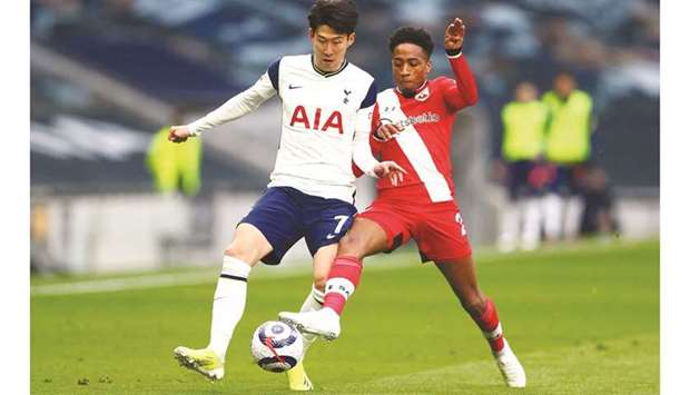 Southampton's Kyle Walker-Peters (right) vies for the ball with Tottenham Hotspur's Son Heung-Min du