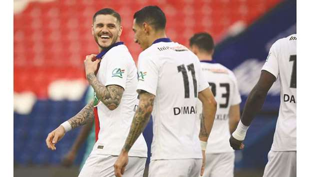 Paris Saint-Germain's forward Mauro Icardi (left) smiles after scoring his team's fourth goal during