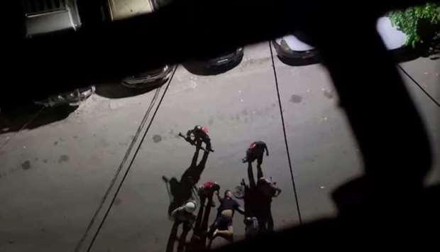 A screen grab taken from a social media video obtained by Reuters shows a man being beaten by securi