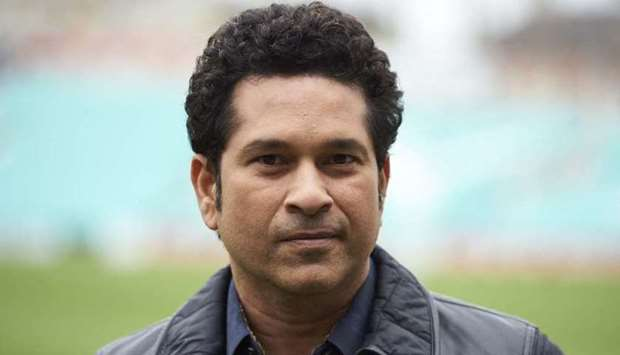 Sachin Teldulkar poses for a photograph during a photocall at the Oval cricket ground in south Londo
