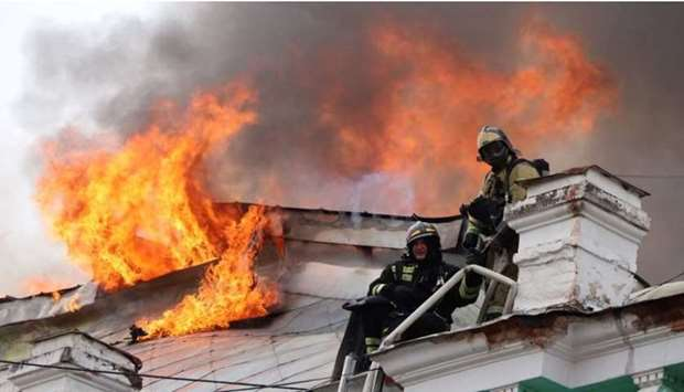 Firefighters work to extinguish a fire at a local clinic of cardiac surgery in the city of Blagovesh