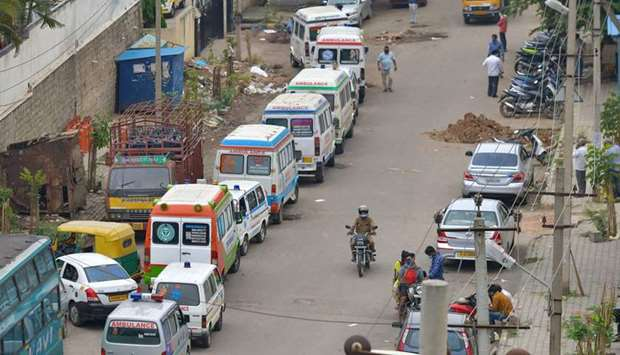 Ambulances carrying the dead victims of Covid-19 coronavirus disease line outside a municipal cremat