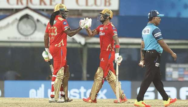 Punjab Kings' KL Rahul and Chris Gayle celebrate after their win over Mumbai Indians in the Indian P