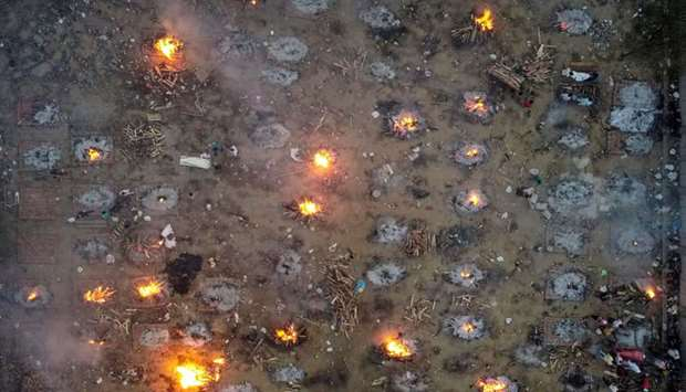 A mass cremation of victims who died due to the coronavirus disease (Covid-19), is seen at a cremato