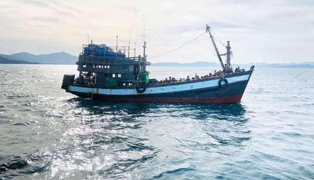 (File photo) A boat thought to be carrying Rohingya migrants is detained off Malaysian earlier in Ap