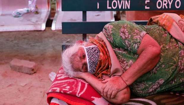 A woman suffering from a breathing difficulty due to the coronavirus disease (COVID-19) waits to rec