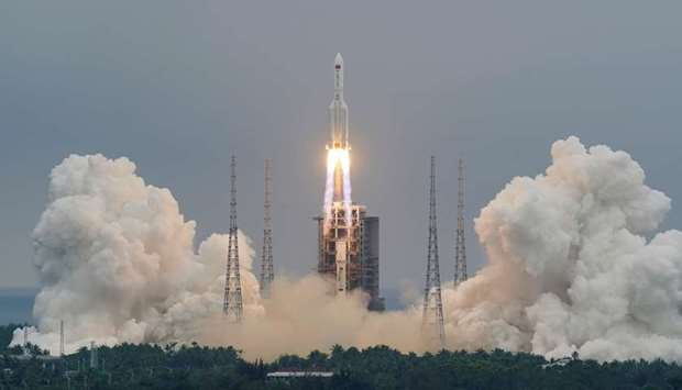 The Long March-5B Y2 rocket, carrying the core module of China's space station Tianhe, takes off fro