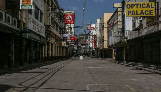 An empty street is seen at Quiapo district in Manila on March 29, 2021, on day one of government's i