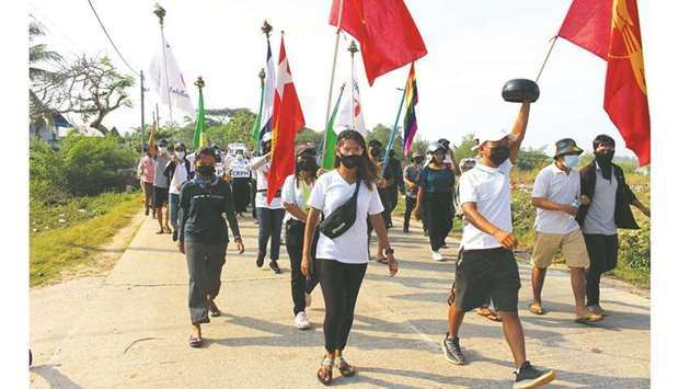 University students, engineers and teachers along with others march as they protest against the mili