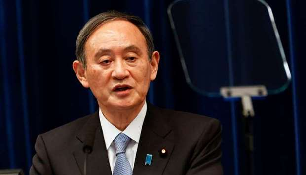 Japan's prime minister, Yoshihide Suga, speaks during a press conference at the prime minister's off