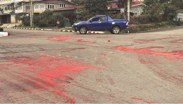 Red paint splashed on a road by protesters, representing blood spilled during demonstrations against