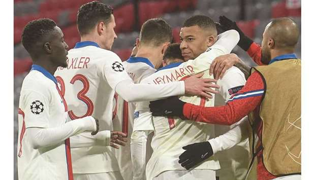 Paris Saint-Germain's Kylian Mbappe (second from right) celebrates with his teammates after scoring