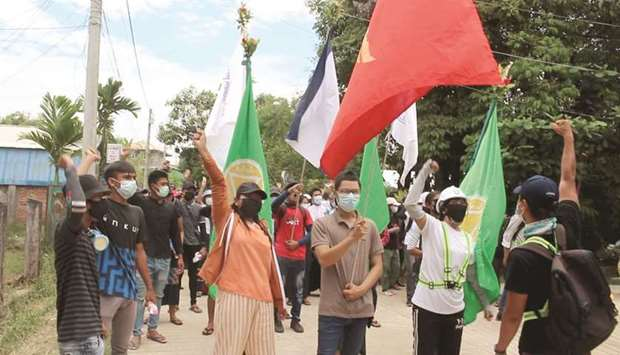 Demonstrators gesture as they protest against the military coup, in Dawei, Myanmar yesterday in this